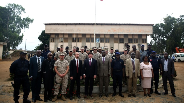 U.S. and Benin officials take time to pose for a photos, Aug. 31, 2015, after the opening ceremony that officially started training between U.S. Marines and sailors and Benin's National Surveillance Police at Benin's National Police Academy in Cotonou, Benin. Today's ceremony marks a new milestone of the partnership between Benin and the U.S. This training is the first time in the Nation Surveillance Police's 10-year history a foreign military has come to train and mentor the specialized unit.