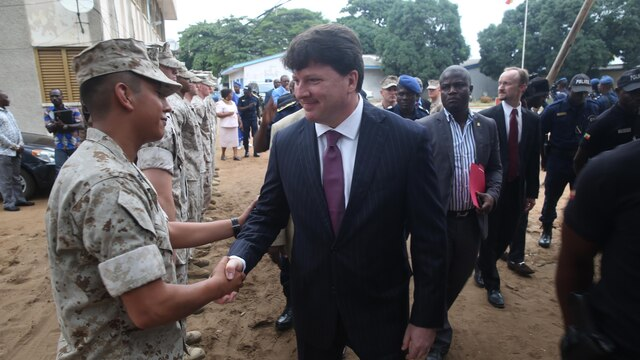 U.S. Embassy Benin Chargé d'affaires Todd Whatley greets U.S Marines and sailors, with Special-Purpose Marine Air-Ground Task Force Crisis Response-Africa Detachment A, during an opening ceremony, Aug. 31, 2015, that officially started training with between the U.S. Marines and sailors and Benin's National Surveillance Police at Benin's National Police Academy in Cotonou, Benin. Today's ceremony marks a new milestone of the partnership between Benin and the U.S. This training is the first time in the Nation Surveillance Police's 10-year history a foreign military has come to train and mentor the specialized unit. Benin's Minister of Interior Placide Azande was also on hand for the ceremony.