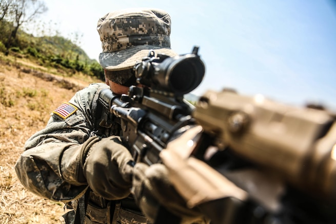 U.S. Army Pvt. Tomas Ordonez prepares to fire his M4 carbine rifle during Garuda Shield 2015 in Cibenda in West Java, Indonesia, Aug. 24, 2015. U.S. Army Pacific sponsored the bilateral exercise and the Indonesian army hosted it to promote regional security and cooperation. Ordonez is assigned to the 25th Infantry Division's Company C, 2nd Battalion, 27th Infantry Regiment, 3rd Infantry Brigade. U.S. Army photo by Spc. Michael Sharp