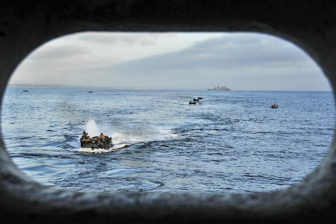 Amphibious assault vehicles prepare to enter the well deck of the amphibious transport dock ship USS New Orleans during Exercise Dawn Blitz 2015 in the Pacific Ocean, Aug. 21, 2015. The training exercise, conducted by the U.S. Marines, includes Japanese, Mexican and New Zealand troops, and involves simulated operations to enhance each country's ability to activate an amphibious task force. U.S. Navy photo by Petty Officer 3rd Class Brandon Cyr