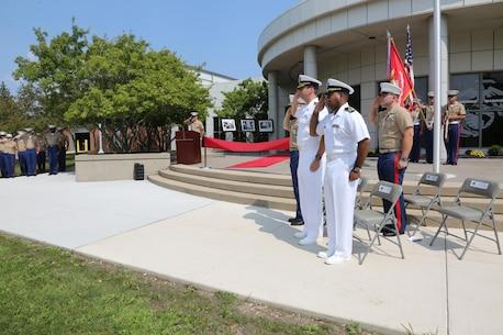 NAVAL STATION GREAT LAKES -- Marines and sailors stationed aboard Naval Station Great Lakes celebrate the official opening of the 9th Marine Corps District's headquarters building, Sept. 1, 2015. The ceremony also commemorated the 78th anniversary of the unit's activation as 9th Reserve District, which was established aboard the Naval Station, Sept. 1, 1937. Col. Jason Morris, the District's commanding officer, spoke during the ceremony about the importance of recruiting and how maintaining a well-qualified, well-trained Marine Corps begins with the individual recruiter on the streets. The District is responsible for recruiting enlisted, officer and prior service Marines across 660,000 square miles and 13 states in the Midwest region.