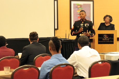SACRAMENTO – Sgt. Reuben Smith, IV, officer selection assistant, Recruiting Station Sacramento, introduces himself to the audience at the Ron Brown Business and Economic Summit here, Aug. 29, 2015. The California Black Chamber of Commerce hosted a youth summit at the event to teach local youths about leadership and business skills. The participants formulated business plans and presented to a panel, who critiques and advised them. (U.S. Marine Corps photo by Staff Sgt. Jacob Harrer)