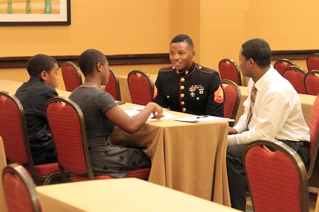 SACRAMENTO – Sgt. Reuben Smith, IV, officer selection assistant, Recruiting Station Sacramento, mentors participants at the Ron Brown Business and Economic Summit here, Aug. 29, 2015. The California Black Chamber of Commerce hosted a youth summit at the event to teach local youths about leadership and business skills. The participants formulated business plans and presented to a panel, who critiques and advised them. (U.S. Marine Corps photo by Staff Sgt. Jacob Harrer)