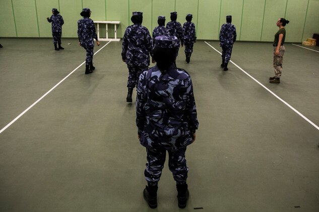 QATAR (Aug 18, 2015) Female with the Qatari Internal Security Forces VIP protection division demonstrate how they execute motorcade operations while partaking in a Subject Matter Expert Exchange with the Qatari Internal Security Forces Female VIP Protection Unit in Qatar. The FPFET was comprised of U.S. Marines with the 15th Marine Expeditionary Unit as well as Soldiers and Sailors with Special Operations Command Central-Forward and Joint Special Operations Task Force-Arabian Peninsula. During the SMEE they covered medical care, marksmanship, and personal security detail strategies. (U.S. Marine Corps photo by Cpl. Anna Albrecht/ Released)