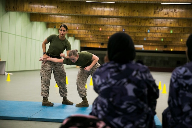 QATAR (AUG. 19, 2015) U.S. Marines with the Female Partner Force Engagement Team demonstrate Marine Corps Martial Arts Program during a subject matter expert exchange with the Qatari Internal Security Forces Female VIP Protection Unit in Qatar. The FPFET was comprised of U.S. Marines with the 15th Marine Expeditionary Unit as well as Soldiers and Sailors with Special Operations Command Central-Forward and Joint Special Operations Task Force-Arabian Peninsula. During the SMEE they covered medical care, marksmanship, and personal security detail strategies. (U.S. Marine Corps photo by Cpl. Anna Albrecht/Released)