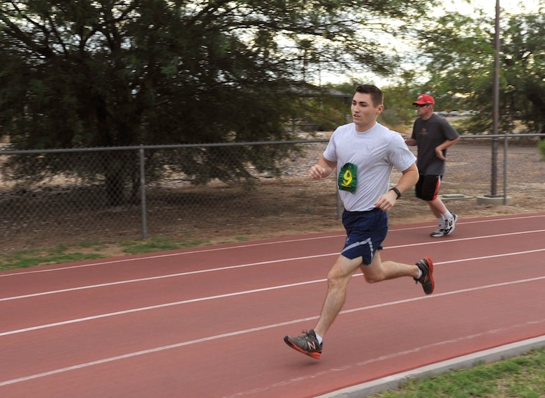 U.S. Air Force First Lieutenant Brian Ingham, 42nd Electronic Combat Mission Squadron EC-130H student pilot, performs the 1.5 mile portion of the fitness assessment at Davis-Monthan Air Force Base, Ariz., July 27, 2015. Ingham was first to complete the running portion of this FA. When an Airman scores an absolute 100 percent on the FA, they receive recognition and have their picture displayed in the lobby of the Tech. Sgt. Arthur J. Benko Fitness and Sports Center. (U.S. Air Force photo by Airman 1st Class Mya M. Crosby/Released)
