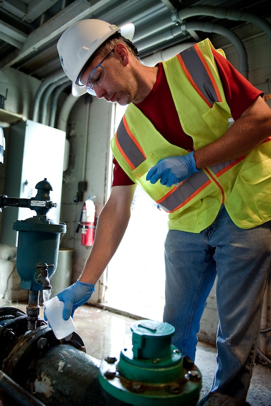 Mathew Lipiec, a contracted environmental engineer, collects water from one of four wells near Grissom Air Reserve Base, Ind., Sept. 2, 2015. The water will be tested for perflourinated compounds (PFCs), a class of synthetic fluorinated organic chemicals used in many industrial and commonly used consumer products. (U.S. Air Force photo/Tech. Sgt. Benjamin Mota)