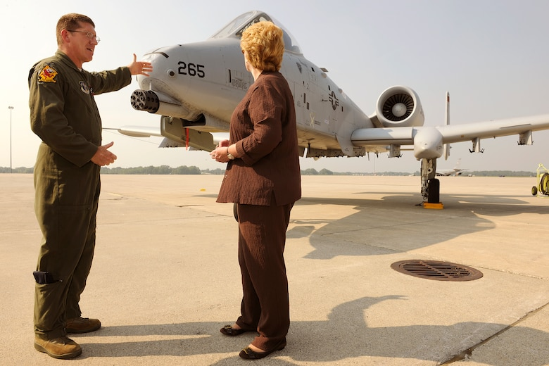 150902-Z-EZ686-085 -- Col. Douglas Champagne, commander of the 127th Operations Group and an A-10 Thunderbolt II pilot, explains the capabilities of the aircraft to U.S. Sen. Debbie Stabenow, D-Mich., during a visit by a Congressional delegation to Selfridge Air National Guard Base, Mich., Sept. 2, 2015. Selfridge was the first stop on a two-day tour of all of Michigan major military installations. Seven Michigan members of Congress and many of their staff aides participated in the trip. (U.S. Air National Guard photos by Master Sgt. David Kujawa / Released)