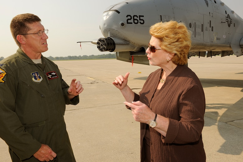 150902-Z-EZ686-087 -- Col. Douglas Champagne, commander of the 127th Operations Group and an A-10 Thunderbolt II pilot, explains the capabilities of the aircraft to U.S. Sen. Debbie Stabenow, D-Mich., during a visit by a Congressional delegation to Selfridge Air National Guard Base, Mich., Sept. 2, 2015. Selfridge was the first stop on a two-day tour of all of Michigan major military installations. Seven Michigan members of Congress and many of their staff aides participated in the trip. (U.S. Air National Guard photos by Master Sgt. David Kujawa / Released)