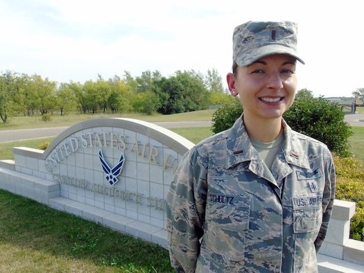 2nd Lt. Emily Schultz, 10th Space Warning Squadron crew commander, poses in front of the base sign at Cavalier Air Force Station, North Dakota, Aug. 31, 2015. Schultz was named the Warrior of the Week for the first week of September 2015. (Courtesy photo by 2nd Lt. Brandy Benesch/Released)