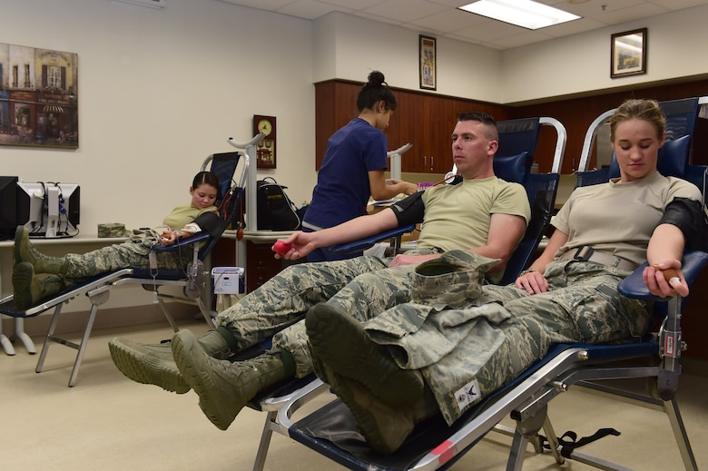 Team Buckley members donate blood during a blood drive hosted by Bonfils Blood Center Sept. 2, 2015, on Buckley Air Force Base, Colo. The blood drive is hosted to raise awareness and donations for those in need. (U.S. Air Force photo by Airman 1st Class Luke W. Nowakowski/Released)