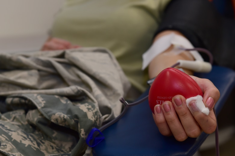 Team Buckley members participate in a blood drive hosted by Bonfils Blood Center Sept. 2, 2015, on Buckley Air Force Base, Colo. The blood drive looks is hosted awareness and donations for those in need. (U.S. Air Force photo by Airman 1st Class Luke W. Nowakowski/Released)