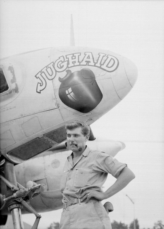 "T/Sgt Chester Krejci poses for a picture with a 35th Photo Recon Squadron F-5E Photo Lightning nicknamed ""Jughaid.""  Krejci served in ""E"" Flight of the squadron at Chihkiang Airfield and witnessed the arrival on 21 August 1945 of the Japanese surrender party in China.  (Courtesy Chester Krejci Family)"