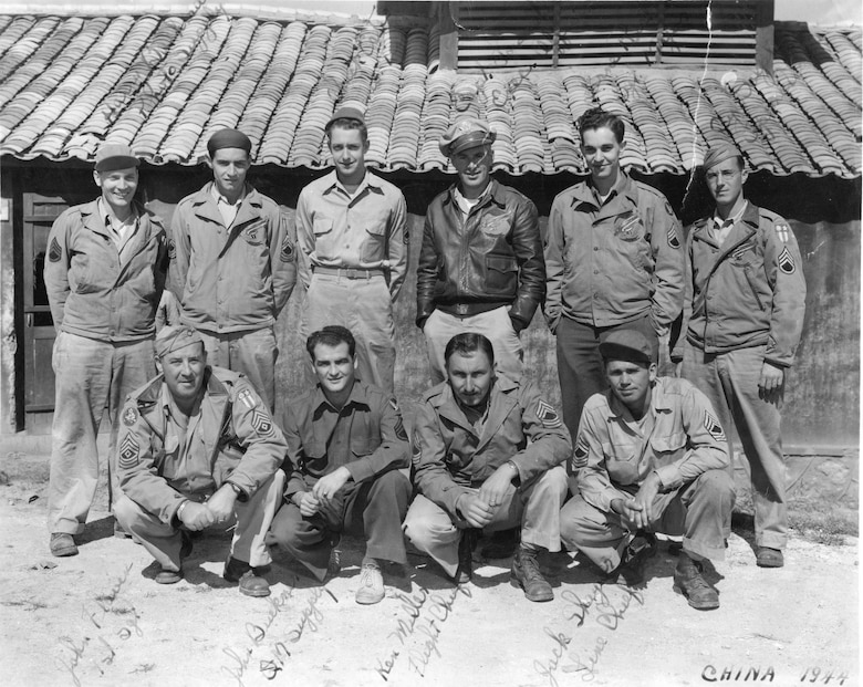 Pictured here are ten of the 13 Oregon National Guard aviation pioneers who reached China in September 1944, in a photo taken at the 35th PRS base at Chanyi Airfield. In the front row, kneeling, from left to right are First Sergeant John Flavin, John Buckner, Kenneth Miller and Jack Shaylor. Standing behind them, from left to right, are Harry Bachman, Roy Wolford, Charles Estes, Harvey Lounsbury, Lorne Restau and Cyrus Dolph. Note the distinctive Redhawk emblem on the jackets of four of the men standing, which was continued in use after the war when the squadron was redesignated as the 123rd Fighter Squadron.  (142FW Archives)