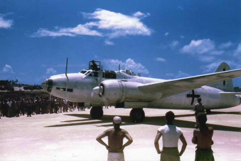Sgt. Fred Hill captured the momentous arrival of an Imperial Japanese Navy Mitsubishi BETTY bomber on Ie Shima, off the coast of Okinawa, on 19 August 1945. To many servicemen witnessing the event this was clear evidence that the war was indeed over.  (Courtesy Mr. Fred Hill)