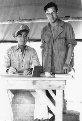 Sgt. Fred H. Hill, 17th Reconnaissance Squadron (Bombardment), stands by 1st Lt. John P. O'Keefe, assigned to a Military Police unit, on Biak Island in 1944.  O'Keefe was the original First Sergeant of the 123rd Observation Squadron before being selected for Officer Candidate School during the war.  (Courtesy Mr. Fred Hill)