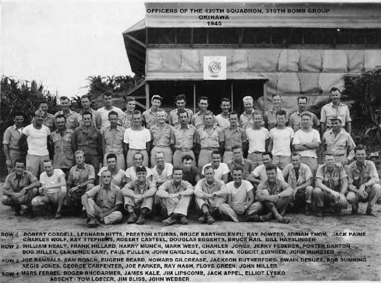 Officers of the 439th Bomb Squadron gather for a picture in front of their mess on Okinawa, late in World War II.  They were part of the 319th Bomb Group which transferred from the war in Europe to help finish the war in the Pacific.  Today the unit is the 114th Fighter Squadron of the Oregon Air National Guard, at Kingsley Field, Oregon. (Courtesy 319th Bomb Group Association)