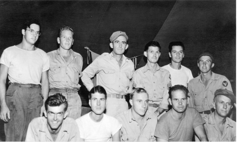 Eleven of Oregon's original Air Guardsmen had a relatively pleasant wartime reunion on the island of Biak, off the northwest coast of New Guinea in the Netherlands East Indies in late September or October of 1944. It was the first gathering between them since leaving Oregon's 123rd Observation Squadron for other air force assignments earlier in the war, as the Army Air Forces reassigned many 123d members to help build up other new air units. Representing five different outfits of the Fifth Air Force, they are (back row, from left), Sgt. Fred H. Hill (17th Reconnaissance Squadron (17RS)), Sgt.Onan S. Beasley, 1st Lt. John P. O'Keefe (a Military Police unit), M/Sgt. Joe H. Weber, S/Sgt. Anthony J. Flabetich, S/Sgt. John L. Donis (110th Tactical Reconnaissance Squadron); (seated, from left) Sgt. Robert W. Casey (17RS), S/Sgt. Robert F. Wall (17RS), S/Sgt. John H. Sopjes (17RS), T/Sgt. Walter M. Barker (17RS) and Pvt. Jack L. Barton. The units the other men belonged to are unknown; there were several units based on Biak in this period, including the 71st Tactical Reconnaissance Group, 345th Bomb Group (Medium) and the 475th Fighter Group.  (142FW Archives)