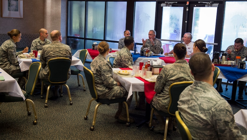 Maj. Gen. Frederick H. Martin, U.S. Air Force Expeditionary Center commander, Joint Base McGuire-Dix-Lakehurst, New Jersey, talks with Airmen and Sailors during a breakfast meeting Sep. 1, 2015, at the Gaylor dining facility on Joint Base Charleston, S.C. The U.S. Air Force Expeditionary Center is the Air Force's Center of Excellence for advanced expeditionary combat support training and education, while also providing direct oversight for en route and installation support, contingency response and partner capacity building mission sets within the global mobility enterprise. The Expeditionary Center provides operational control of the Expeditionary Operations School and administrative control for six wings and two groups within Air Mobility Command. (U.S. Air Force photo/Airman 1st Class Clayton Cupit)