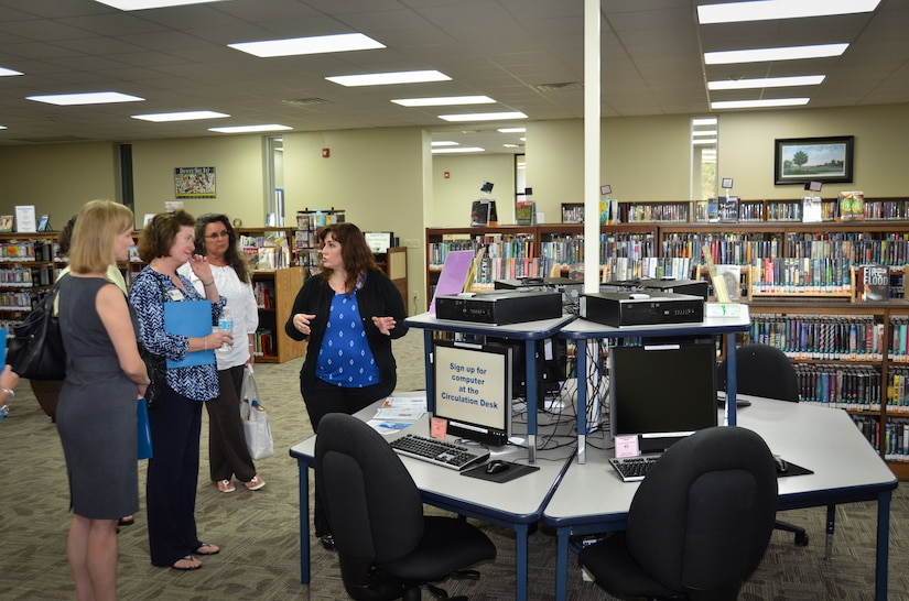 (Right) Angela Aschenbrenner, Joint Base Charleston Libraries director, gives a tour to Barbara Martin, wife of Maj. Gen. Frederick Martin, commander of the U.S. Air Force Expeditionary Center, during a base visit, Sept. 2, 2015 at Joint Base Charleston – Weapons Station, S.C. The purpose of the visit was to provide an overview of the library services available on the joint base. (U.S. Air Force photo/Staff Sgt. AJ Hyatt)