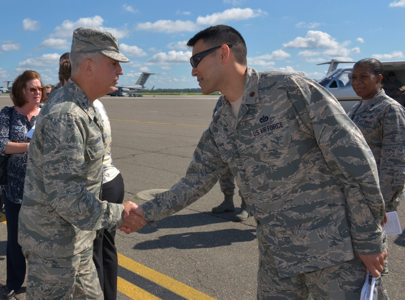 (From left to right) Maj. Gen. Frederick Martin, U.S. Air Force Expeditionary Center commander, Joint Base McGuire-Dix-Lakehurst, NJ, greets with Maj. Woo Suk Chun, 628th Civil Engineer Squadron operations flight commander, Joint Base Charleston, SC, on the flight line at JB Charleston, SC, Sept. 1, 2015. Martin was accompanied by his wife, Barbara, Brig. Gen. James Scanlan, Mobilization Assistant to the commander of the U.S. Air Force Expeditionary Center, John Hood, honorary commander of the U.S. Air Force Expeditionary Center and Chief Master Sgt. Peter Stone, U.S. Air Force. EC command chief. During his visit, Martin toured various locations across the Air Base and Weapons Station where he was able to interact with several of Joint Base Charleston's Mission Partners. The U.S. Air Force Expeditionary Center is the Air Force's Center of Excellence for advanced expeditionary combat support training and education, while also providing direct oversight for en route and installation support, contingency response and partner capacity building mission sets within the global mobility enterprise. (U.S. Air Force photo/Airman 1st Class Thomas T. Charlton)