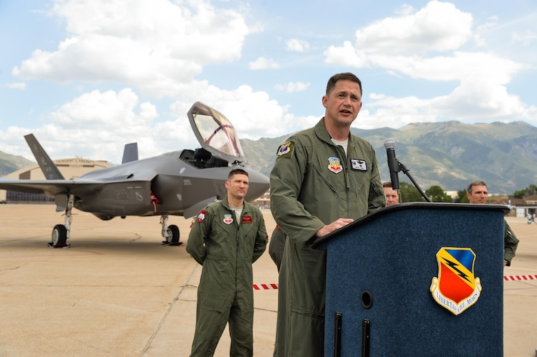 Col. David Lyons, 388th Fighter Wing commander, speaks to Airmen, civic leaders and media after delivering an operational F-35A Lightning II aircraft to Hill Air Force Base, Utah, Sept. 2, 2015. Lyons, along with Lt. Col. Yosef Morris, 34th Fighter Squadron director of operations, delivered the first two jets, known as AF-77 and AF-78, at approximately 1 p.m. MDT after a 90-minute flight from the F-35 production facility in Fort Worth, Texas.  These aircraft are the first two of up to 72 jets that will be assigned to both the active-duty 388th and Reserve 419th Fighter Wings at Hill. (U.S. Air Force photo by Ron Bradshaw/Released)