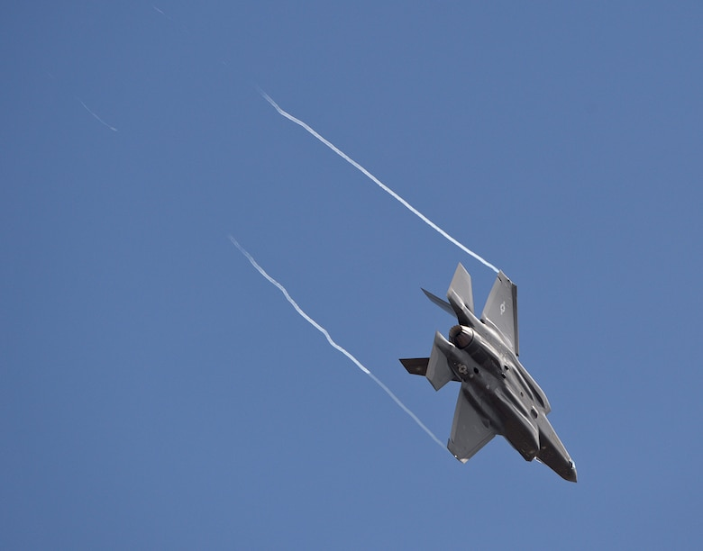An F-35A Lightning II aircraft flies over Hill Air Force Base, Utah, Sept. 2, 2015. After landing, this aircraft and another became the first two operational F-35s to arrive at the base. The rest of the fleet of up to 72 F-35s will be coming in on a staggered basis, spread through 2019. There are several factors that make Hill ideally suited to receive the F-35 including access to the Utah Test and Training Range; Hill's robust base infrastructure; and its support team made up of dedicated Airmen from the active duty 388th Fighter Wing and Reserve 419th Fighter Wing. (U.S. Air Force photo by Alex R. Lloyd/Released)