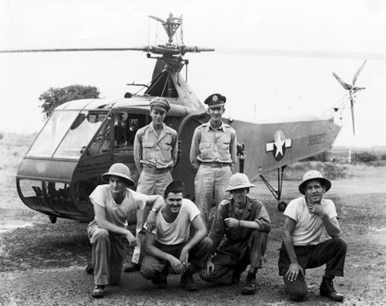 U.S. Air Force Museum photo, probably taken in January 1945, shows Lt. Carter Harman (standing left), with ground crew, including his crew-chief/mechanic, Sgt. Jim Phelan (front row right). Lt. Frank Peterson, a veteran R-4 test pilot who performed a later epic Burma rescue mission with a YR-4B, stands beside Lt. Harman.