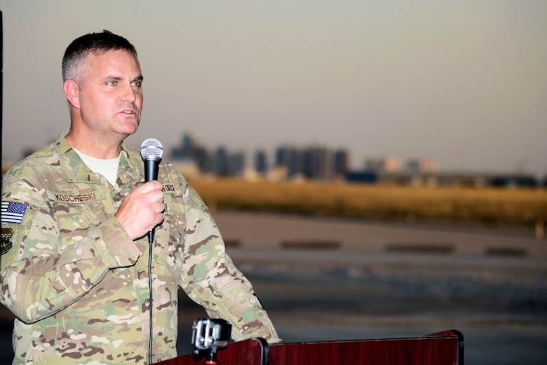 U.S. Air Force Col. Michael Koscheski, 332nd Air Expeditionary Wing commander, speaks during the 1st Expeditionary Rescue Group activation and assumption of command ceremony at an undisclosed location in Southwest Asia, Sept. 1, 2015. Koscheski spoke of the importance of the activation of the rescue squadron and the aid it will provide the theater in Operation Inherent Resolve. (U.S. Air Force photo by Senior Airman Racheal E. Watson/Released)