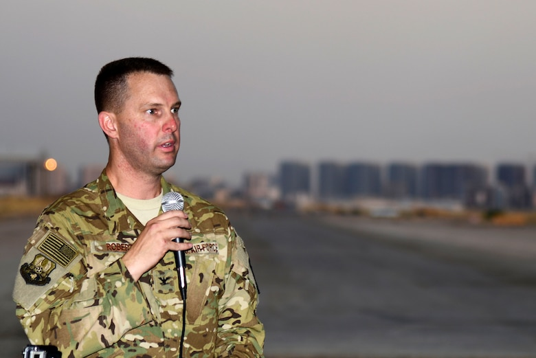 U.S. Air Force Col. Gregory Roberts, 1st Expeditionary Rescue Group commander, speaks during the 1st Expeditionary Rescue Group activation ceremony at an undisclosed location in Southwest Asia, Sept. 1, 2015. Roberts shared his command vision to support efforts to degrade and defeat the Islamic State and to move ahead based on lessons learned throughout history. (U.S. Air Force photo by Senior Airman Racheal E. Watson/Released)