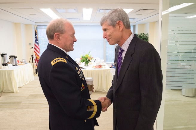 Army Gen. Martin E. Dempsey, chairman of the Joint Chiefs of Staff,  is greeted by retired Gen. Norton A. Schwartz at the Business Executives for National Security headquarters in Washington, D.C., Sep. 2, 2015. BENS is a nonpartisan non-profit that supports the U.S. government by applying best business practice solutions to its most difficult national security problems. DoD photo by U.S. Army Staff Sgt. Sean K. Harp