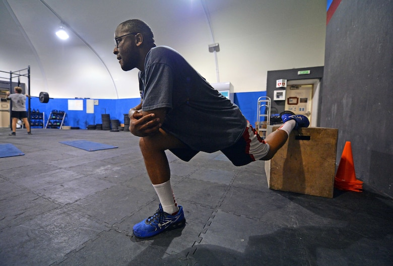 Staff Sgt. Jamey, 380th Expeditionary Security Forces Squadron member, stretches after completing strength and agility exercises at undisclosed location in Southwest Asia Sept. 3, 2015. Jamey is participating in the Physical Therapy Clinic's strength and agility program to help rehabilitate his knees. (U.S. Air Force photo/Tech. Sgt. Jeff Andrejcik)