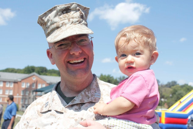 Capt. Nathan Adams and his youngest daughter attend the Training and Education Command Family Day Picnic at Barnett Field, Aug. 27. Adams works in TECOM as the deputy staff judge advocate.