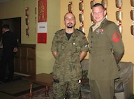 Sebastian N. Czyz, a Poznan, Poland, native who, at the time, served in the Polish Navy, poses for a photo with U.S. Marine Sgt. John Cramer, who was serving with Headquarters U.S. Marine Corps Forces, Europe, in 2007. Czyz finally achieved his childhood goal of joining the Marine Corps on June 15, 2015. He is scheduled to ship to recruit training in April, 2016.  (Photo courtesy of Sebastian N. Czyz)