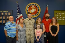 U.S. Marine Corps Corporal William Pawley poses with his family following his promotion to his present rank at a recruiting office in Newark, Delaware, August 3, 2015. Pawley, a native of Wilmington, Delaware, and a 2011 graduate of Delcastle High School recently returned from a seven-month deployment to the Mediterranean Sea, where he served as an airframes mechanic aboard the USS Iwo Jima. (U.S. Marine Corps photo by Sgt. Bryan Nygaard/Released)