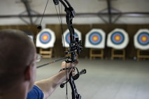 Retired Tech. Sgt. Matthew Hiniker, a wounded warrior, pulls back an arrow with a bite tab during an adaptive archery class as part of the Air Force Wounded Warrior Program Warrior Care event Aug. 27, 2015, at Joint Base Lewis-McChord, Wash. The Warrior Care event featured adaptive and rehabilitative sports activities, career readiness, recovering Airman mentorship and caregiver training. (U.S. Air Force photo/Staff Sgt. Ashley Hyatt)