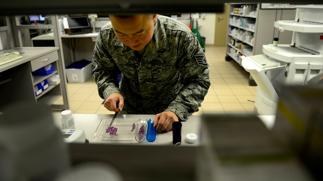 Staff Sgt. Charles Shin, a 31st Medical Support Squadron pharmacy technician, fills a prescription Aug. 31, 2015, at Aviano Air Base, Italy. The pharmacy fills more than 200 prescriptions a day. (U.S. Air Force photo/Senior Airman Areca T. Wilson)