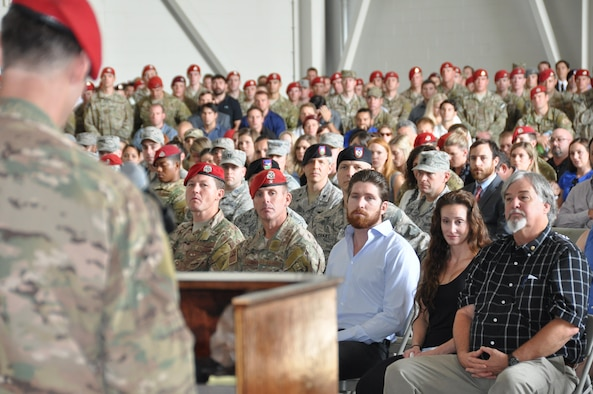 Family members and teammates from the 21st Special Tactics Squadron and throughout the special operations community listen as Maj. Stewart Parker, 21st STS commander, remembers Staff Sgt. Forrest Sibley in a memorial service at Pope Army Airfield, N.C. Sept. 3, 2015. Sibley, 31, was killed at a vehicle checkpoint near Camp Antonik, Afghanistan, Aug. 26, 2015. He was a combat controller at the 21st STS and deployed in support of Operation Freedom's Sentinel. (U.S. Air Force photo by Lt. Col. James R. Wilson/Released)