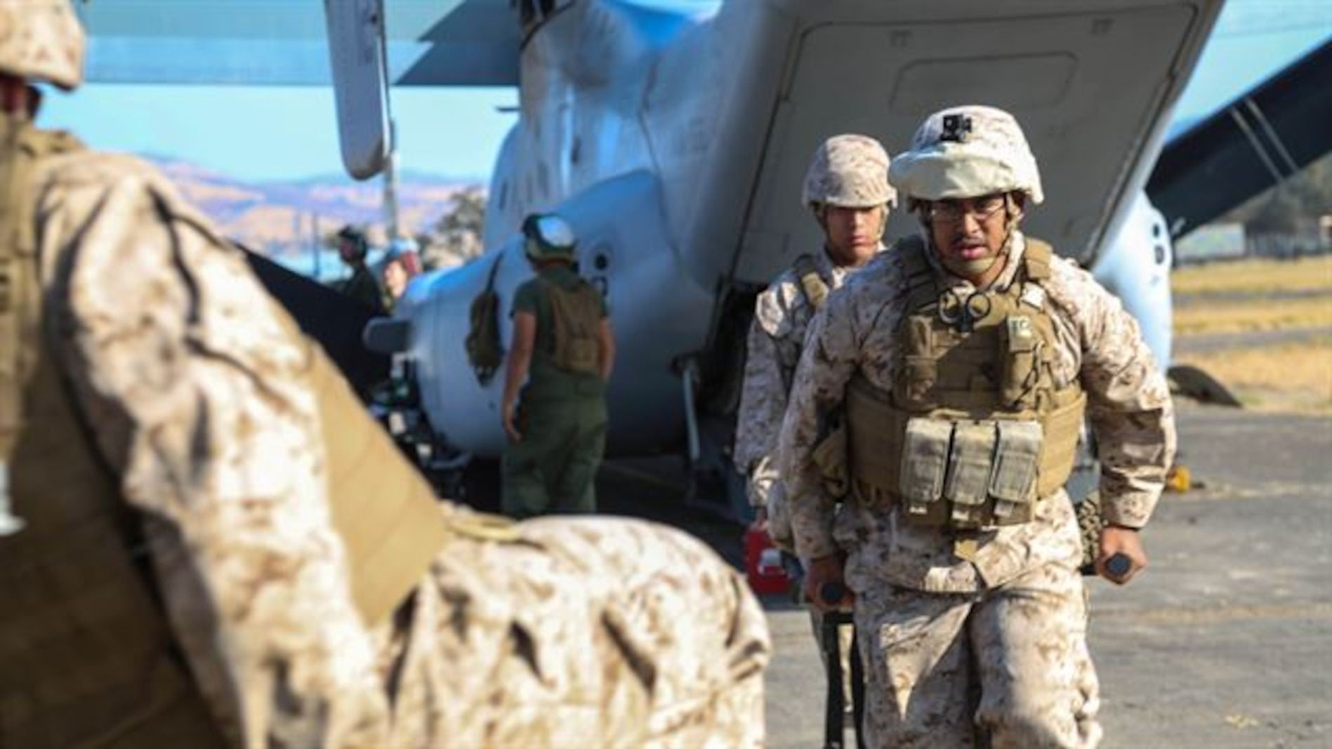13th MEU Shock Trauma Platoon: From air to care  Petty Officer 2nd Class Phillip Lopez (front) and Seaman Jordan Saco, U.S. Navy Corpsmen with Shock Trauma Platoon, Combat Logistics Battalion 13, the logistics combat element for the 13th Marine Expeditionary Unit, carry a simulated casualty on a stretcher to the rear of a medical aid vehicle at Fort Hunter Liggett, California, during training to familiarize medical personnel with attending to casualties arriving on the flight line at Realistic Urban Training (RUT) Exercise, Sept. 2, 2015. RUT is the final ground-based training requirement prior to deployment as the 13th MEU moves toward operating embarked at sea.