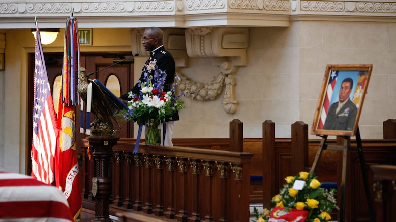 Lt. Gen. Ronald L. Bailey, Deputy Commandant Plans, Polices, and Operations, speaks about Lt. Gen. Frank E. Petersen, Jr. (ret.) during a memorial service at the U.S. Naval Academy in Annapolis, Md., Sept. 3, 2015. Petersen died Aug. 25, 2015, after succumbing to lung cancer. During his career, Petersen flew more than 350 combat missions and more than 4,000 hours in various military aircraft.