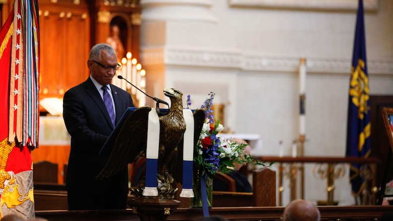 Maj. Gen. Charles F. Bolden (ret.), Administrator of NASA, speaks about Lt. Gen. Frank E. Petersen, Jr. (ret.) during a memorial service at the U.S. Naval Academy in Annapolis, Md., Sept. 3, 2015. Petersen died Aug. 25, 2015, after succumbing to lung cancer. During his career, Petersen flew more than 350 combat missions and more than 4,000 hours in various military aircraft.