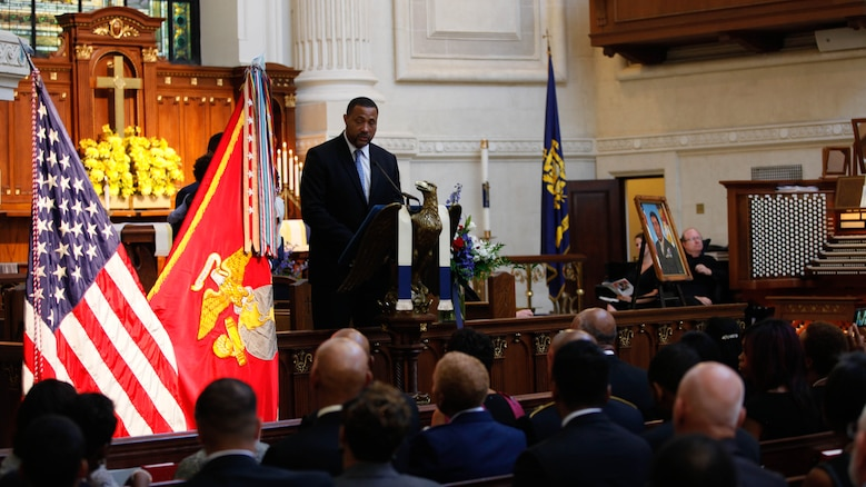 Frank E. Petersen III speaks about his father during a memorial service at the U.S. Naval Academy in Annapolis, Md., Sept. 3, 2015. Lt. Gen. Frank E. Petersen, Jr. (ret.), died Aug. 25, 2015, after succumbing to lung cancer. During his career, Petersen flew more than 350 combat missions and more than 4,000 hours in various military aircraft.