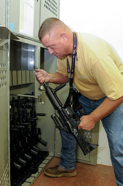 Brian Alexander, 90th Logistics Readiness Squadron materials handler, places an M-4 carbine in the armory of the 90th LRS Warehouse on F.E. Warren Air Force Base, Wyo., Sept. 2, 2015. Weapons not in use by the 90th Security Forces Group are stored by the 90th LRS. (U.S. Air Force photo by Senior Airman Jason Wiese)