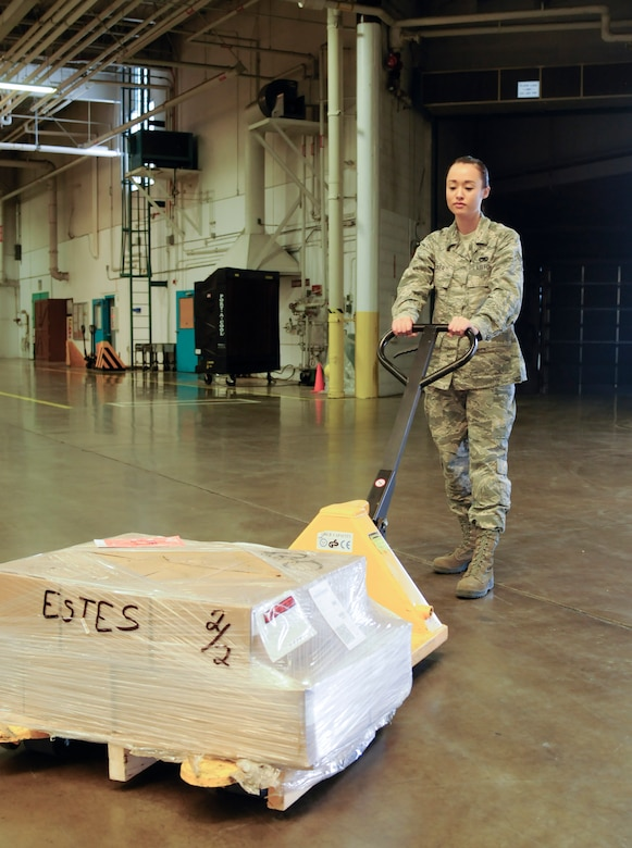 Senior Airman Susan Kicker, 90th Logistics Readiness Squadron Inbound Management clerk, pulls a pallet in the 90th LRS Warehouse on F.E. Warren Air Force Base, Wyo., Sept. 2, 2015. Inbound cargo Airmen handle received cargo shipped to base and distribute it to the organizations on base who need it. (U.S. Air Force photo by Senior Airman Jason Wiese)