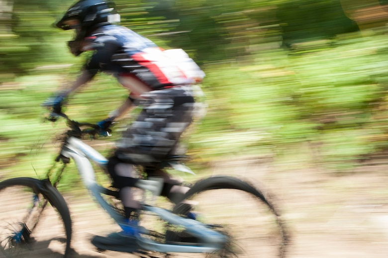 Airman 1st Class Brad Hoffler, 90th Missile Security Forces Squadron, rides a mountain biking trail on Mount Werner in the Routt National Forest, Colo., Aug. 29, 2015. Hoffler and 18 other riders from F.E. Warren Air Force Base participated in an Outdoor Recreation trip which took them to a downhill mountain bike park. (U.S. Air Force photo by Lan Kim)