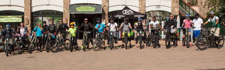 Participants of an F.E. Warren Air Force Base Outdoor Recreation trip pose for a group photo at a bike park in Steamboat Springs, Colo., Aug. 29, 2015. The trip consisted of a day of riding the downhill mountain biking trails carved into Mount Werner in Routt National Forest and soaking at a local hot spring afterwards.  (U.S. Air Force photo by Lan Kim)