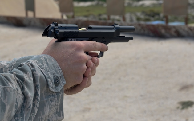 Staff Sgt. Travis Straw, 644th Combat Communications Squadron cyber system technician, reloads his M9 pistol before firing downrange Sept. 1, 2015 at the Combat Arms Training and Maintenance range on Andersen Air Force Base, Guam. The CATM mission is to ensure all weapons utilized by 36th Wing members are functional, maintained and ready when the Airmen are called to duty. (U.S. Air Force photo by Staff Sgt. Robert Hicks/Released)