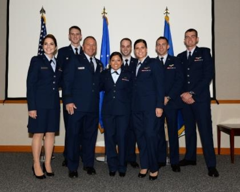 Brig. Gen. David Hicks, 1st Air Force (Air Forces Northern) vice commander, stands with newly-pinned Air-Battle-Management Course graduates at the 337th Air Control Squadron here Aug. 26. The general was the featured speaker at the graduation ceremony.  (Air Force Photo Released/Airman 1st Class Cody Miller)