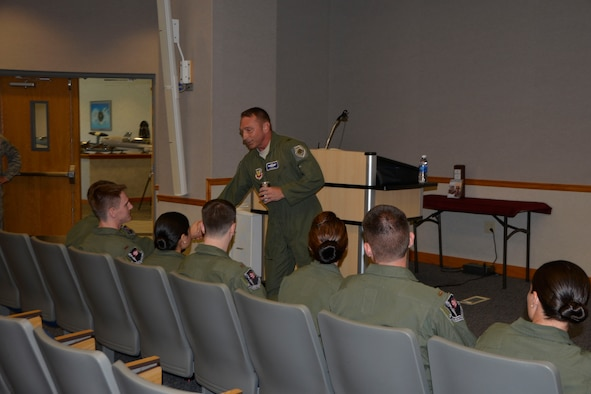 Brig. Gen. David Hicks, 1st Air Force (Air Forces Northern) vice commander, greets some Air-Battle-Manager Course graduates at the 337th Air Control Squadron here prior to a mentoring  question-and-answer session with students and course staff on their graduation day Aug. 26. Hicks later presided over the ceremony where the graduates received their wings. (Air Force Photo Released/Mary McHale)