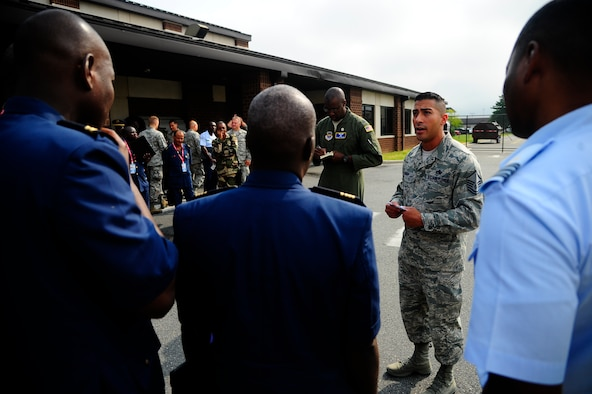 Master Sgt. Carlos Damian, 305th Aircraft Maintenance Squadron, briefs visiting African military personnel at Joint Base McGuire-Dix-Lakehurst during the African Partnership Flight hosted by the 621st Contingency Response Wing Sept. 2, 2015. During the weeklong engagement, U.S. Airmen from JB MDL focused on sharing ideas and experiences with African counterparts in the realm of logistics management and aircraft maintenance in order to develop mutual understanding and strengthen relationships between participants. (U.S. Air Force photo by 1st Lt. Jake Bailey)